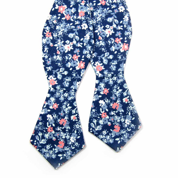 Atlanta Self Tie Bow Tie. Navy background with small dusty blue, white, and blush pink flowers.