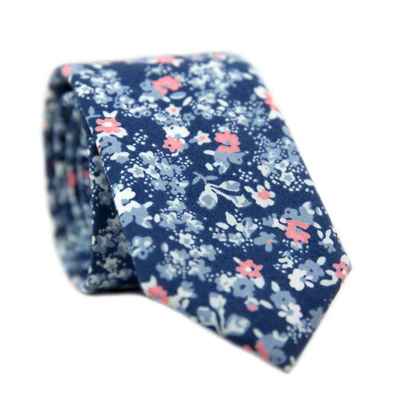 Atlanta Skinny Tie. Navy background with small dusty blue, white, and blush pink flowers.