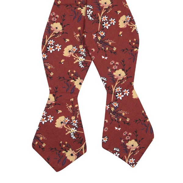 Autumn Self Tie Bow Tie. Red background with tan, peach and white flowers with black stems and leaves.