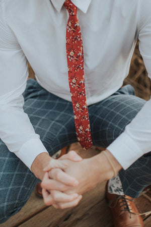 Autumn tie worn with a white shirt and blue gingham pants.