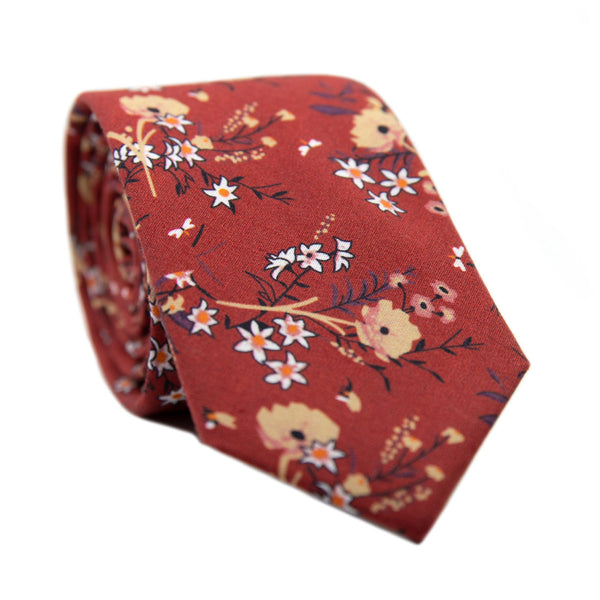 Autumn Skinny Tie. Red background with tan, peach and white flowers with black stems and leaves.