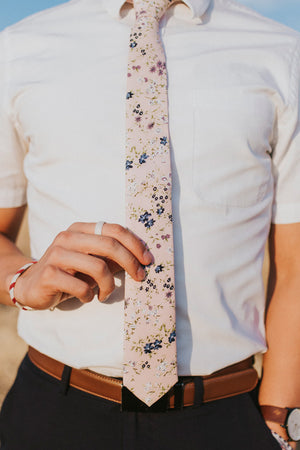 Babys Breath tie worn with a white shirt and black pants.