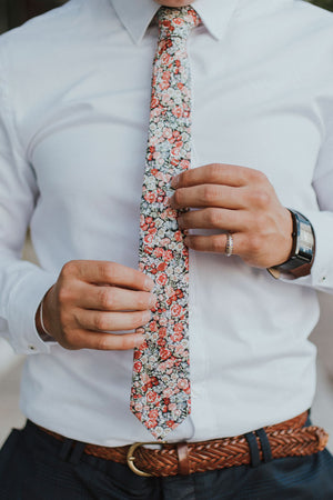 Bed of Roses tie worn with a white shirt, brown belt and blue pants.
