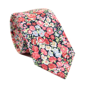 Bed of Roses Skinny Tie. Navy blue background with pink, red, white and lavender flowers and green leaves.
