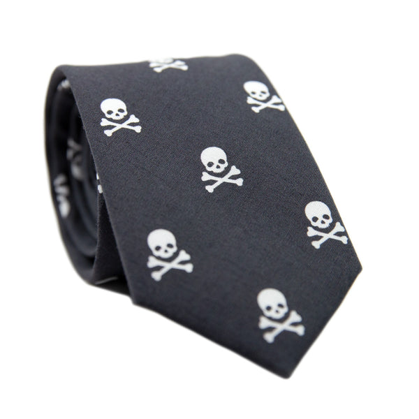 Skulls Skinny Tie. Black background with small white skulls and crossbones all over the tie.