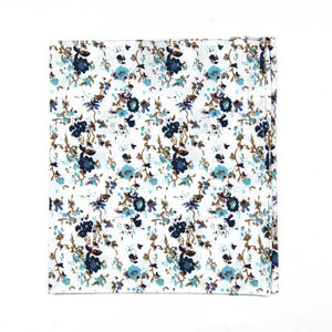 Blue Bloom Pocket Square. White background, navy and light blue flowers, brown branches.