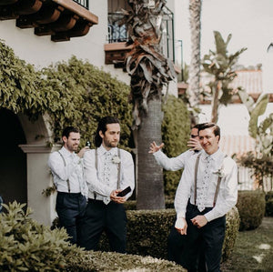Four groomsmen at a wedding wearing Blue Bloom tie with white shirts.