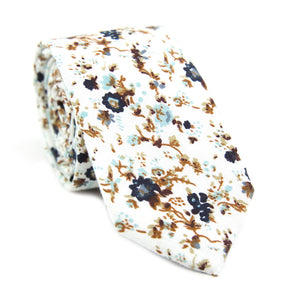 Blue Bloom skinny tie. White background, navy and light blue flowers, brown branches.