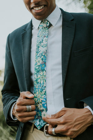 Blue Haven tie worn with a white shirt, black suit jacket and tan pants.