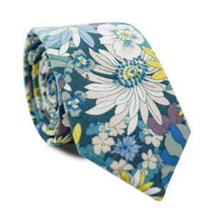 Blue Haven Skinny Tie. Turquoise background with blue, white, tan, yellow and purple flowers.
