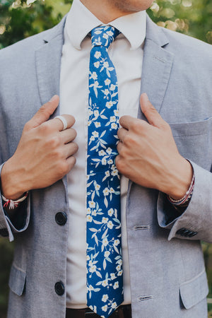 Blue Marlin tie worn with a white shirt and gray suit jacket.