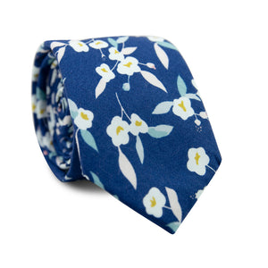 Blue Marlin Skinny Tie. Navy blue background with white flowers, yellow flower centers and blush and dusty leaves.