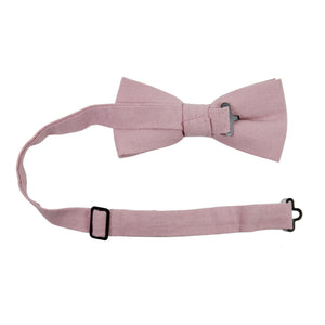 Blush Pre-Tied Bow Tie with adjustable neck strap. Solid blush pink textured fabric.