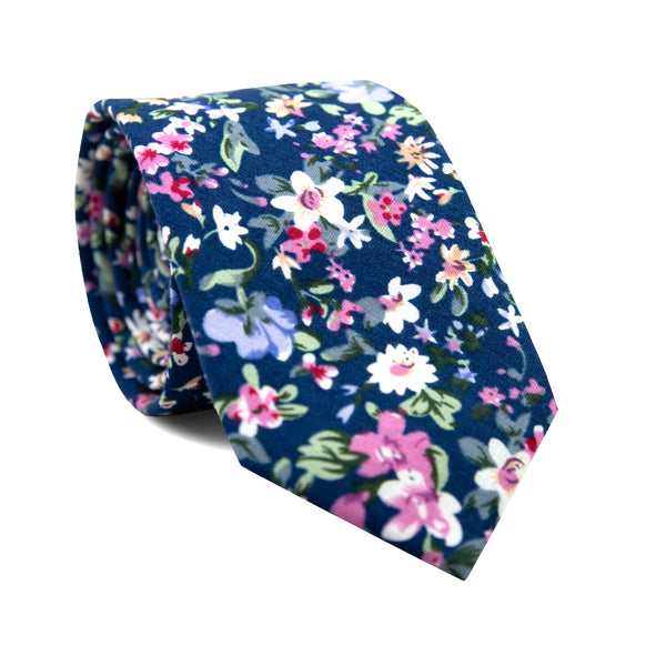 Botanical Skinny Tie. Navy blue background with white, lavender, pink and red flowers with green stems and leaves.