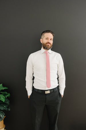 Bubblegum tie worn with a white shirt, black belt and black pants.