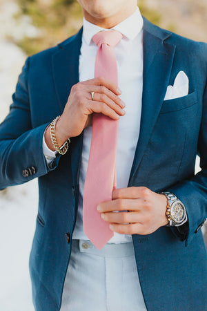 Bubblegum tie worn with a white shirt, navy blazer and light blue pants.