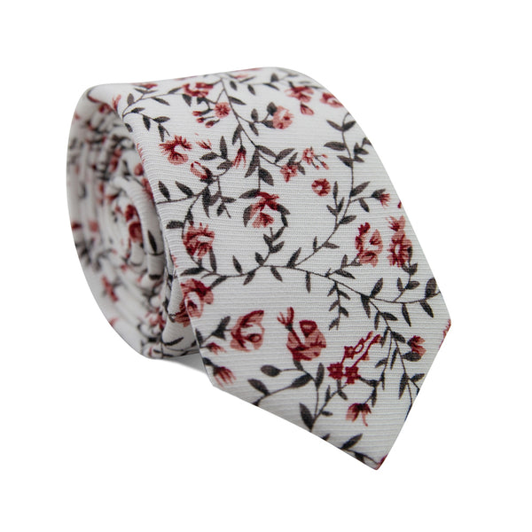 Burning Brush Skinny Tie. White background with small red flowers and green leafy vines throughout.