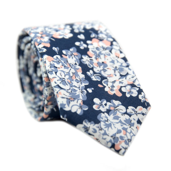 California Poppy Skinny Tie. Navy blue background with small white, peach, and dusty blue flowers.