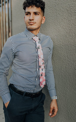 Cherry Blossom tie worn with a blue and white gingham shirt and blue pants.