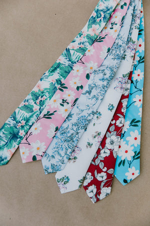 Cherry Blossom tie laying next to 5 other floral skinny ties.