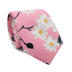 Cherry Blossom Skinny Tie. Pink background with white flowers, black stems, green leaves and yellow flower centers.