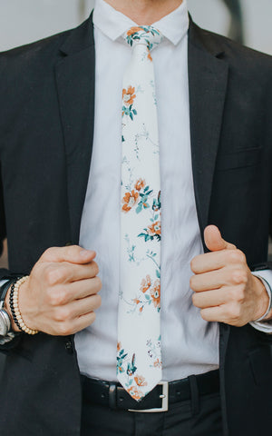 Copper Blooms tie worn with a white shirt and black suit.