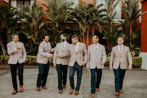 Coral Void tie worn by 6 groomsmen with a white shirt, tan suit jacket, navy blue pants and brown leather shoes.