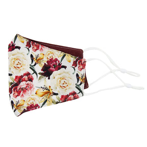 Coral Void and Merlot Reversible Face Mask. Outside is white background with ivory, maroon and gold flowers and green stems and leaves. Inside is solid burgundy textured fabric. White adjustable straps to loop over ears.