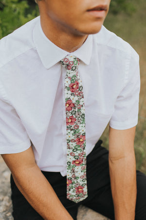 Cosmos tie worn with a white shirt and black pants.