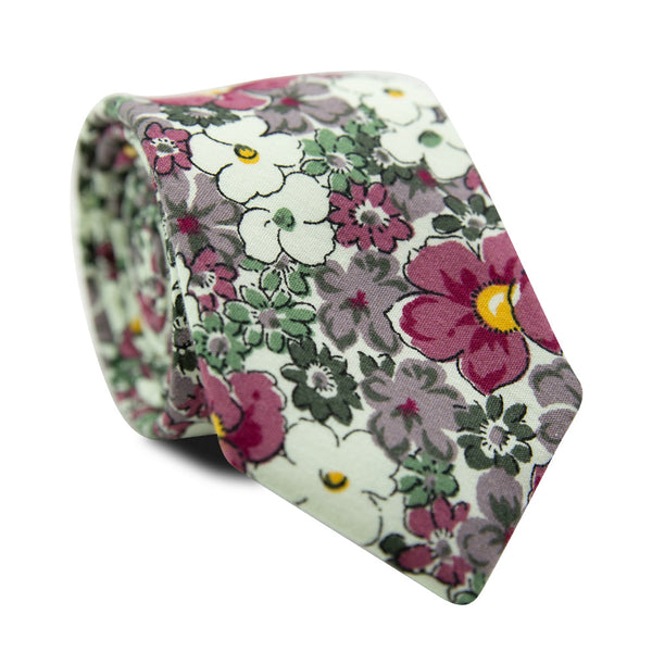 Cosmos Skinny Tie. Cream background with white, green, lavender and mauve flowers that have small yellow centers.