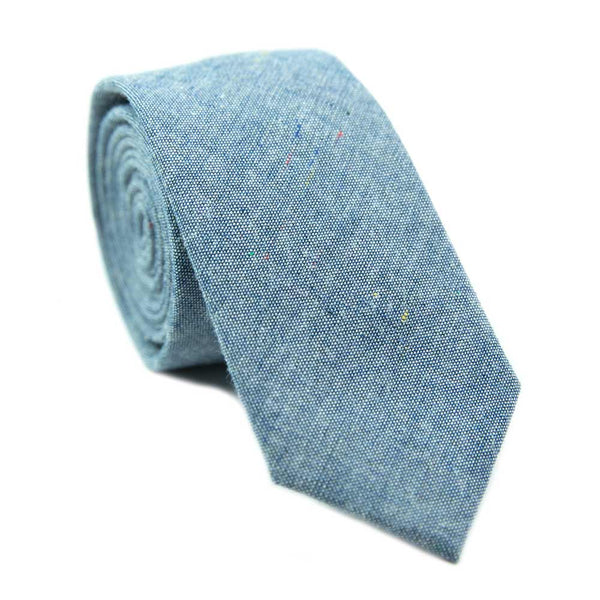 Crew skinny tie. Blue textured background with small spots of navy, yellow and red.