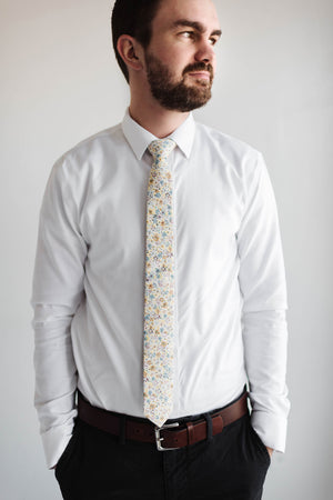 Daffodil tie worn with a white shirt and black pants.