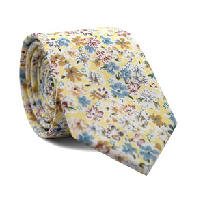 Daffodil Skinny Tie. Yellow background with blue, gold and maroon flowers with green leaves.