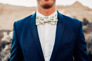 Desert Sun Bow Tie worn with a white shirt and navy suit jacket.