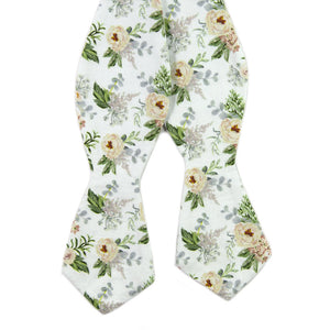 Desert Sun Self Tie Bow Tie. White background with round yellow flowers, green and silver leaves.