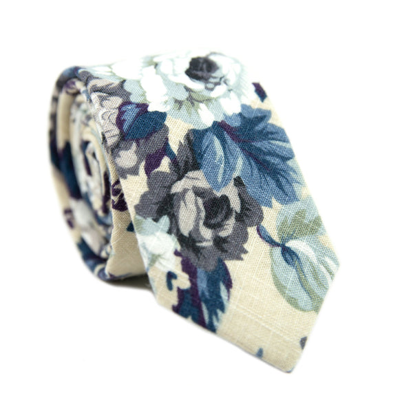 Dreamy Fields Skinny Tie. Cream background with dusty blue, white and gray flowers with navy blue and purple leaves.