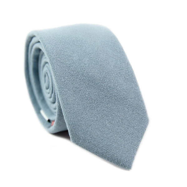 Dusty Skinny Tie. Solid light blue textured fabric.