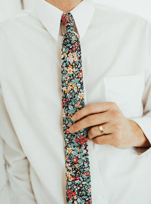 Electric Feel tie worn with a white shirt.