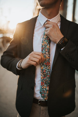 Electric Feel tie worn with a white shirt and charcoal gray suit jacket.