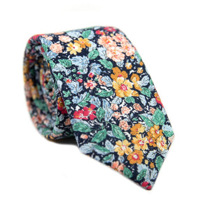 Electric Feel Skinny Tie. Dark navy background with yellow, gold and red flowers, green and blue leaves.