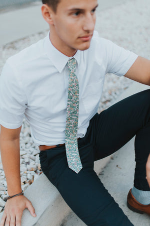Faded Jade tie worn with a white shirt and navy blue pants.