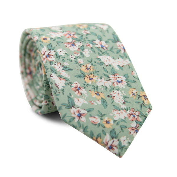 Faded Jade Skinny Tie. Sage background with white, blush and yellow flowers with blue flower centers, dark sage leaves.
