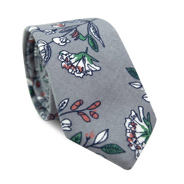 Fall Escape Skinny Tie. Gray background with white and green flowers and leaves and orange accents.
