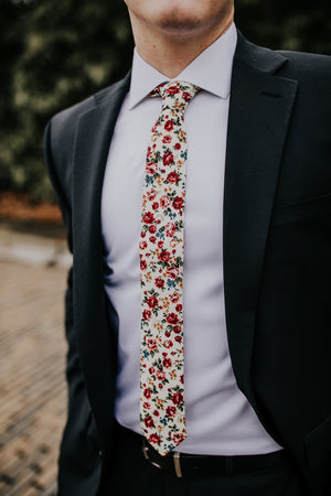 Fiore tie worn with a white shirt and black suit.