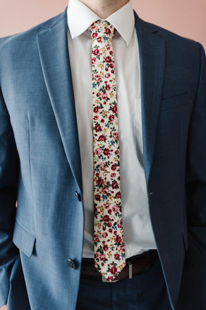 Fiore tie worn with a white shirt and blue suit.