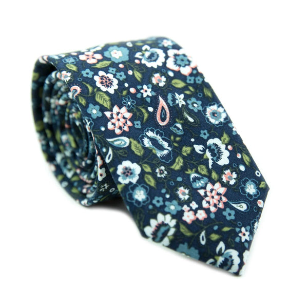 First Date skinny tie. Navy background with white, blue and peach flowers. Also has green leaves and some paisley design.