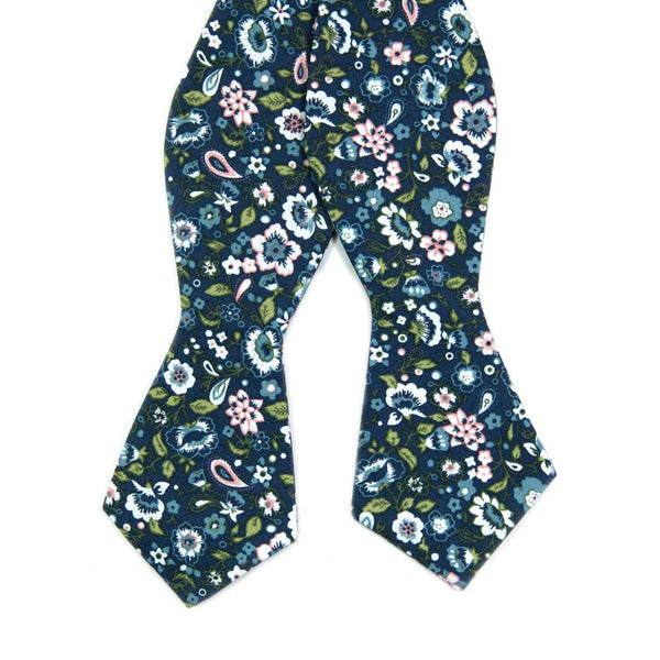First Date Self Tie Bow Tie. Navy background with white, blue and peach flowers. Also has green leaves and some paisley design.