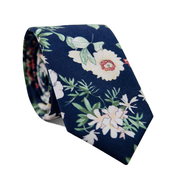 Floral Fig Skinny Tie. Navy background with yellow, pink and red flowers and green leaves throughout.