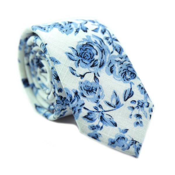 French Garden Skinny Tie. Textured white background with light blue flowers and leaves.