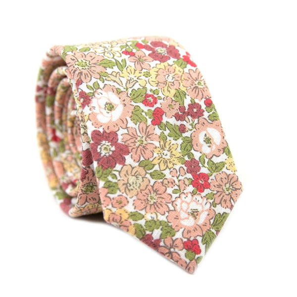Fresh Spring Skinny Tie. White background with lots of small red, green, peach, yellow and white flowers throughout.